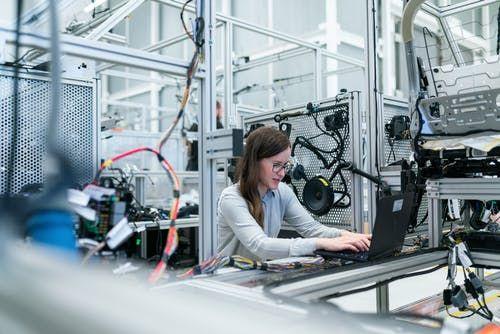 Women working on machine - Fintech Evolution – Technology Advancements Changing the Fintech Sector